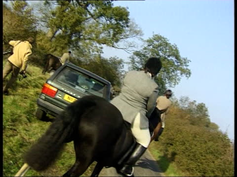 Oxon EXT Huntsmen and hounds along road and across fields CS Hounds around camera Jonathan Chapman intvwd If you stop fox hunting what do you stop...
