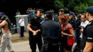 Fracking protests and arrests in Sussex ENGLAND Sussex Balcombe EXT Police officers holding back protesters / Police / crowd of demonstrators...