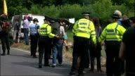 protests in Balcombe ENGLAND West Sussex Balcombe EXT WS police on road with campaigners and tents by side of the road / GVs police surrounding lorry...