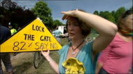 protests in Balcombe Katie Dunne interview SOT / lorry leaving as police hold back protesters / GVs effigy by side of road