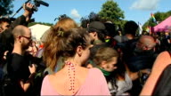 Sussex Balcombe EXT Protesters / demonstrators with arms in tubes linked together and chanting 'Frack Off' / protesters / demonstrators signing /...