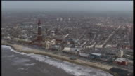 Fracking to continue with close monitoring ENGLAND Lancashire Blackpool VIEWs / AERIALs Blackpool tower with rooftops of suburban houses in...