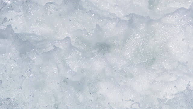 Frame-filling foaming bubbling whitewater in ultra-slow motion