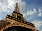 France, Paris, clouds passing Eiffel Tower, low angle view