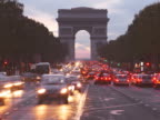 France, Paris, traffic moving through Arc de Triomphe at night