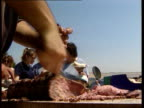 France refuses to lift ban LIB ENGLAND West Sussex CS Joint of beef being carved at public barbecue to mark the end of the export ban on British beef...