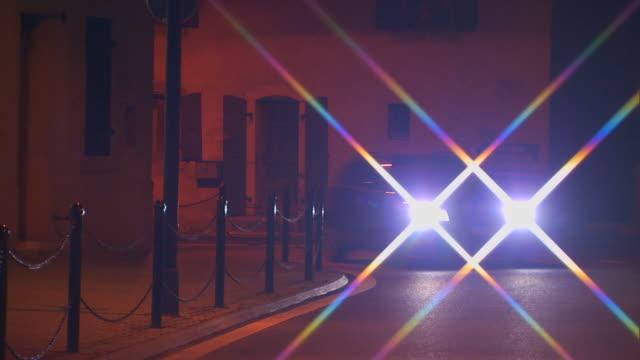 FranceCar coming around a corner at night