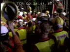 Channel tunnel CF CMS French tunnelling machine turning TMS Workers in hard hats PULL OUT lots more cheering and clapping CMS Tunnel workers drinking...