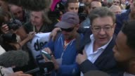 France's far left leader Jean Luc Melenchon joined unions as they launched a day of strikes and protests Tuesday against Emmanuel Macron's flagship...