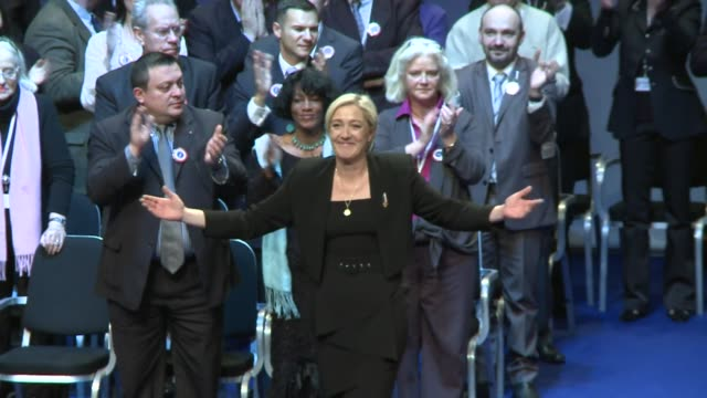 France's National Front crowned founder JeanMarie Le Pen's daughter Marine its new leader Sunday looking to soften the antiimmigrant party's image...