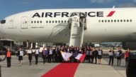France's triumphant Olympic bid committee received a heroes welcome at Charles de Gaulle airport just outside Paris on Friday after unanimously being...