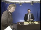 TV franchises ITN LIB London ITN Superchannel Studio Margaret Thatcher peering into autocue PULL OUT as newsreader John Suchet reading news in b/g...