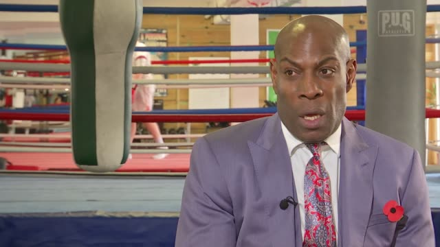 Frank Bruno interview about depression and treatment ENGLAND London INT Frank Bruno interview SOT Bruno signing gloves with autograph
