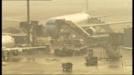 Frankfurt Airport Aeroplane as passengers disembark / Plane towed along runway / General view runway
