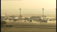 Frankfurt Airport More foggy runway includes parked planes and planes taking off and landing includes Gulf Air plane
