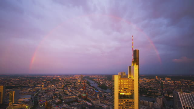 Frankfurt am Main - Rainbow over the city and the Commerzbank Tower at sunset