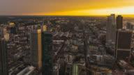 T/L Frankfurt am Main - Skyline - panning shot of Frankfurt's central station, fair ground and financial district at sunset