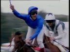 Frankie Dettori waving whip in celebration holds fingers up indicating seven wins at Royal Ascot in 1996