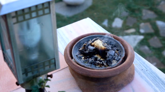 Frankincense burning on a hot coal. Frankincense is an aromatic resin, used for religious rites