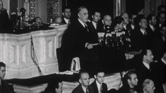Franklin D Roosevelt asking congress to declare war on Japan after bombing of Pearl Harbor / Washington D