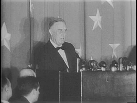 Franklin D Roosevelt gives speech at podium to White House Correspondents Association
