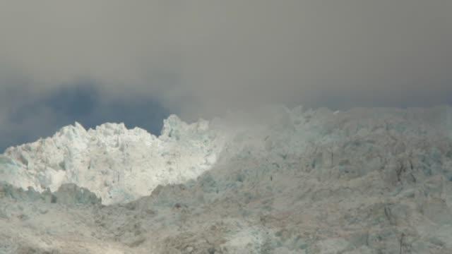 Franz Josef Glacier in Westland Tai Poutini National Park with dark glacier visible under cloud cover