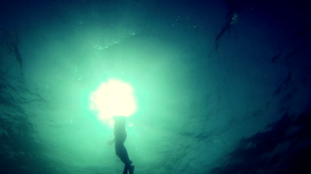 Free diver emerging from the abyss
