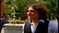 Free music festival on Thames Embankment ENGLAND London Thames Embankment EXT Reporter to camera PAN TO Alex Zane LIVE interview SOT On the music...