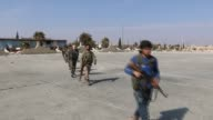 Free Syrian Army fighters advance towards the center of northern Syria's AlBab town as part of the ongoing Operation Euphrates Shield on February 11...