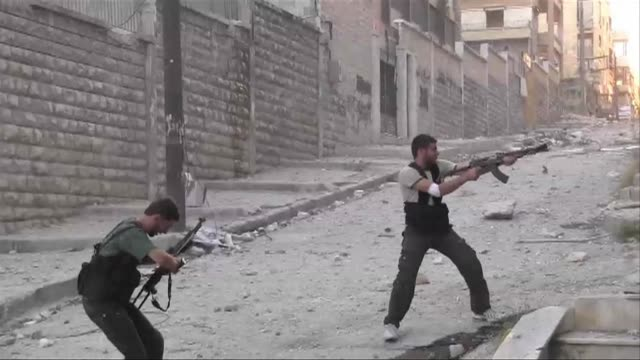 Free Syrian Army rebels continue to try to muster as many fighters as they can to challenge army sniper and tank positions in the strategic...
