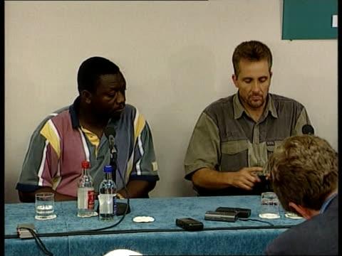 Freed journalists return from Liberia ITN London Heathrow Airport Tim Lambon press conference SOT Talks of international efforts to free them Car...
