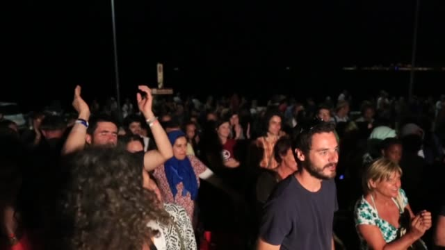 A freedom song created by migrants on the coast of Ventimiglia on the FrenchItalian border on July 3 2015 Around 250 migrants most of them...
