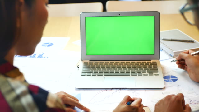 freelance worker using Laptop with Green screen, Chroma key