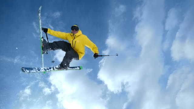 SLO MO TS Freestyle skier performing a backflip with a grab variation