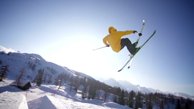 Freestyle skier performing a trick in a snow park