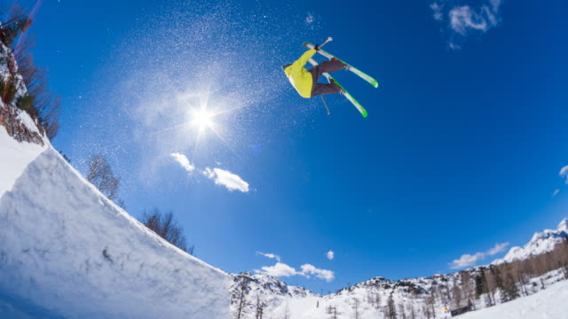 Freestyle skier performing jump stunt in a snow park