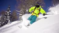 Freestyle skier riding powder snow