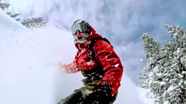 TW Freestyle snowboarder in the wilderness on beautiful day