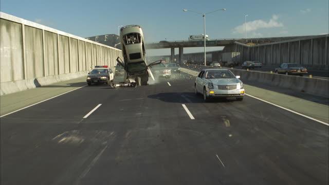 SLO MO REAR POV Freeway traffic, cars flipping and crashing