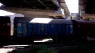 Freight Train crossing under the bridge