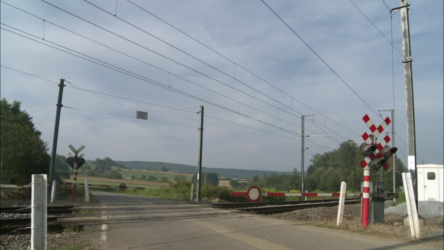 MS Freight train riding through railroad crossing, St. Remy, Belgium