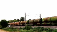 Freight train with petroleum tank cars passing