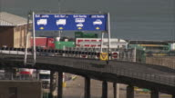 Freight trucks move along a dock at the Port of Dover.