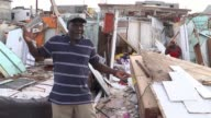 French authorities tackle aftermath of Hurricane Irma ANGUILLA EXT Boat tied to damaged jetty as reporter stands next Gap in the planking of the...