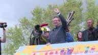 French farleft presidential candidate JeanLuc Melenchon boards a barge in a northeast suburb of the French capital for his latest quirky campaign...