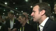 French Finance minister Emmanuel Macron wore a Je suis Charlie sticker as he visited the booths of French start up companies at the Consumer...
