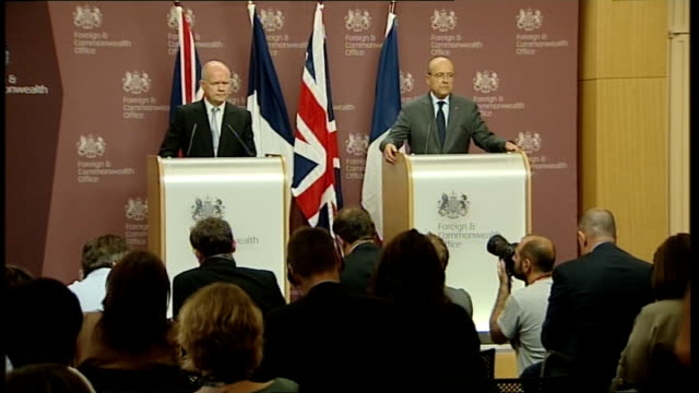 French Foreign Minister Alain Juppe visits UK for talks Press conference Question unheard Hague answer SOT Talks of discussing situation in Norway...