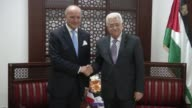 French Foreign minister Laurent Fabius is welcomed by his Palestinian counterpart Riyad alMalki in the West Bank city of Ramallah on June 21 2015...