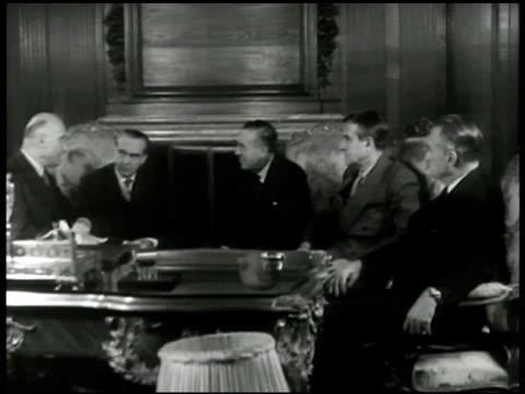 French Foreign Minister Robert Schuman sitting w/ US Diplomat Averell Harriman ECA's Paul Hoffman US Ambassador Jefferson Caffery talking France