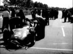 French Grand Prix at Caen FRANCE Caen EXT GV Cars assembled / CU Engine being adjusted / Another engine ditto Jean Behra into car / Front view cars...